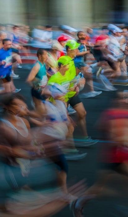 Runners run along side each other